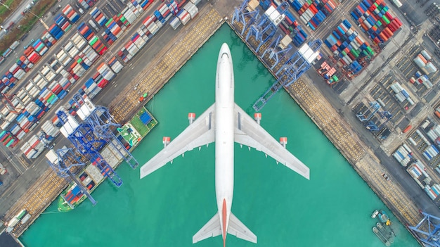 Container ships and transport aircraft in the export and import business and logistics Premium Photo