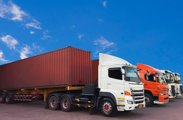 Container trucks transportation parked with a blue sky. Premium Photo