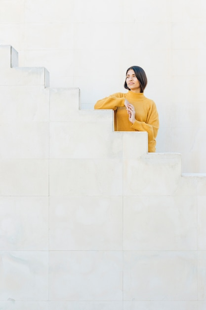 Contemplated woman standing on staircase Free Photo