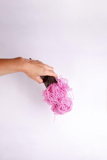 Contemporary art concept. yarn ball ice cream. funny fast food minimal project Premium Photo