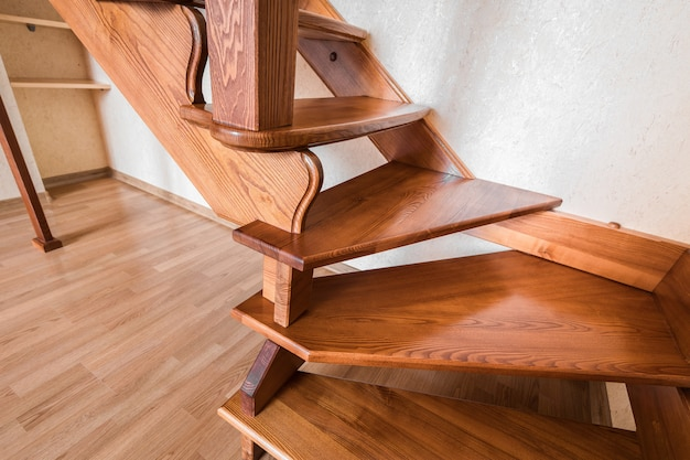 Contemporary brown wooden stairs in the house Premium Photo