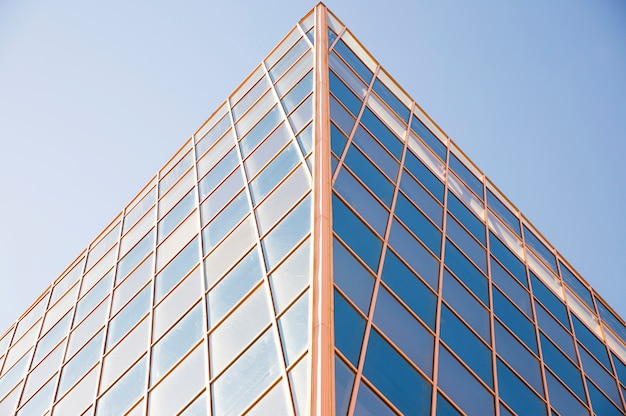 Contemporary building exterior against blue sky in the daylight Free Photo