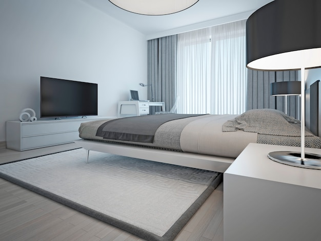 Contemporary monochrome hotel room with laid elegant bed and furniture light gray color and elegant chrome lamps with black shades. Premium Photo