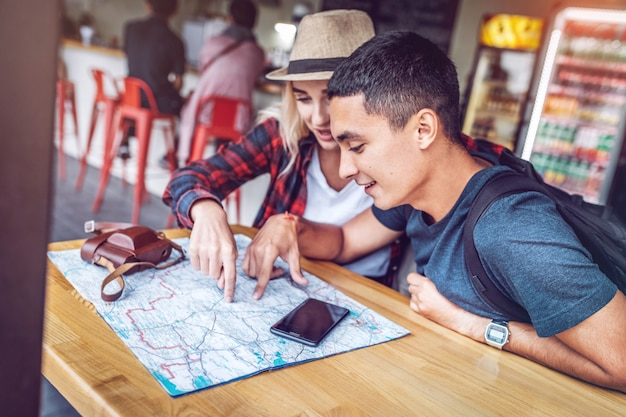 Premium Photo | Content couple with map planning route