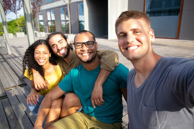 Content friends taking selfie outdoors Free Photo