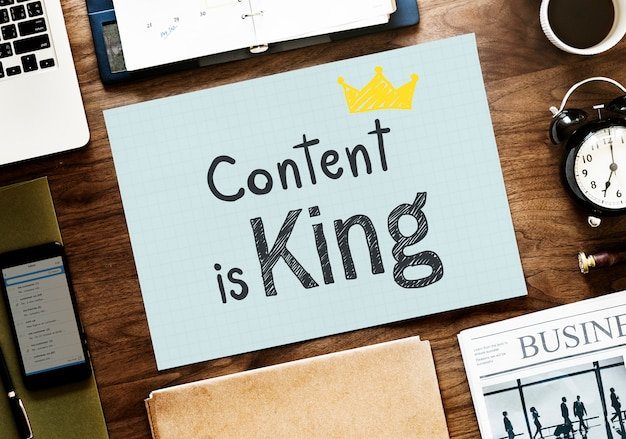 Content is king written on a paper Premium Photo