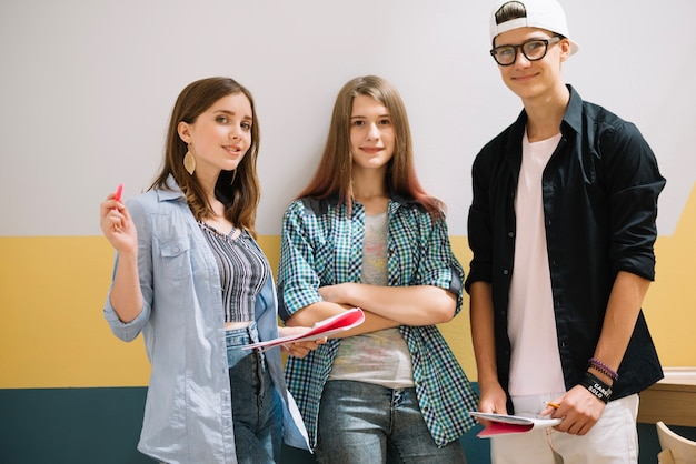 Content teenagers posing together Free Photo