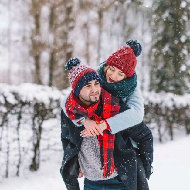 Content trendy couple in winter woods Free Photo