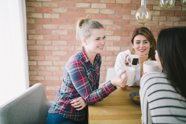 Content women relaxing with tea Free Photo