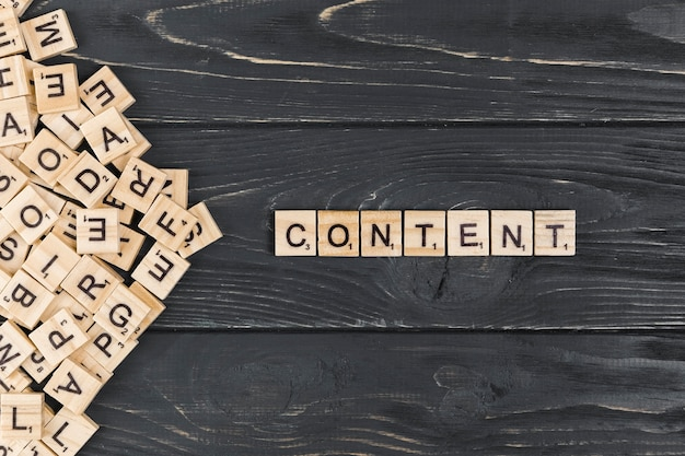 Content word on wooden background Free Photo