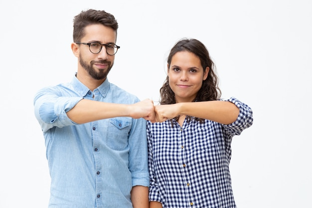 Content young couple touching fists Free Photo