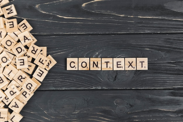 Context word on wooden background Free Photo