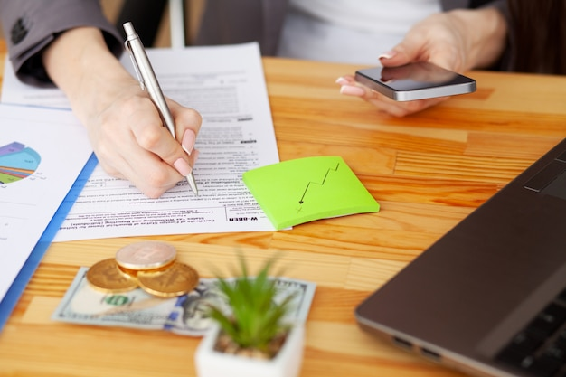 Contract. blank of paper is on a wooden desk. blank a4 paper is in the middle of wood office desk table with supplies. top view with copyspace, flat lay Premium Photo