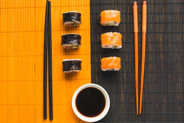 Contrast of sushi plating on bamboo mat Free Photo