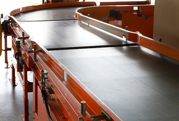 Conveyor belt in warehouse distribution. Premium Photo