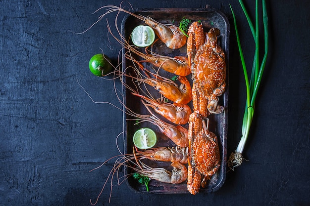 Cook seafood with shrimp and crab on the table. Premium Photo