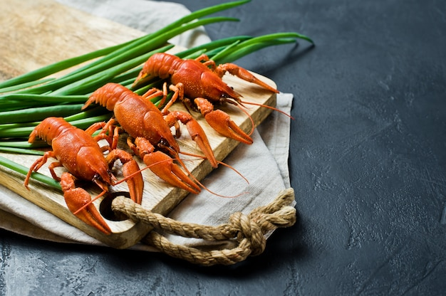 Cooked crayfish on a wooden chopping board. Premium Photo
