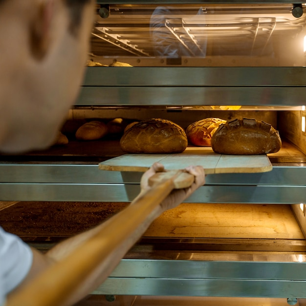 Cooked fresh breads in furnace Free Photo