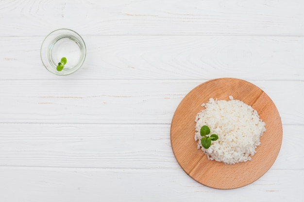 Cooked rice on board with water Free Photo