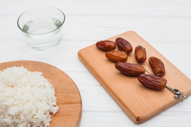 Cooked rice with dates fruit on board Free Photo