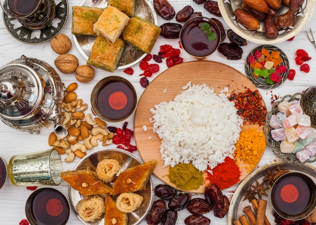 Cooked rice with spices and sweets on table Free Photo
