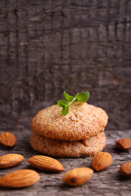 Cookies on a dark background with almonds Premium Photo