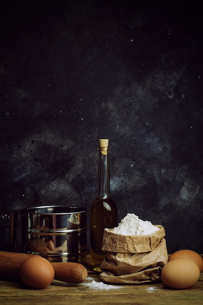 Cooking and baking background. old kitchen with products and ingredients for dough and baking bread, pasta and pizza Premium Photo