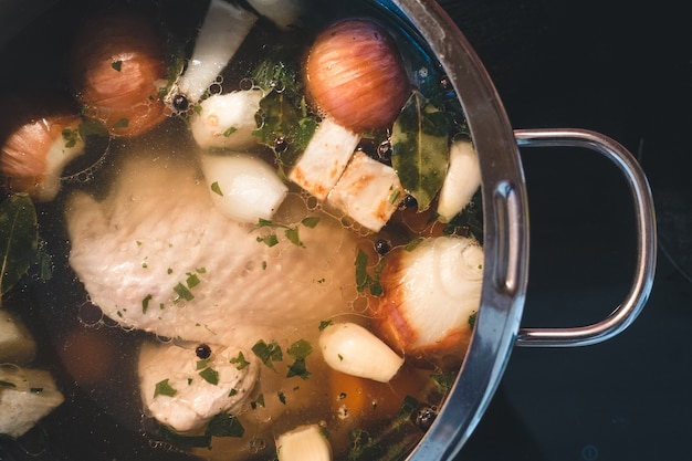 Cooking chicken broth Free Photo