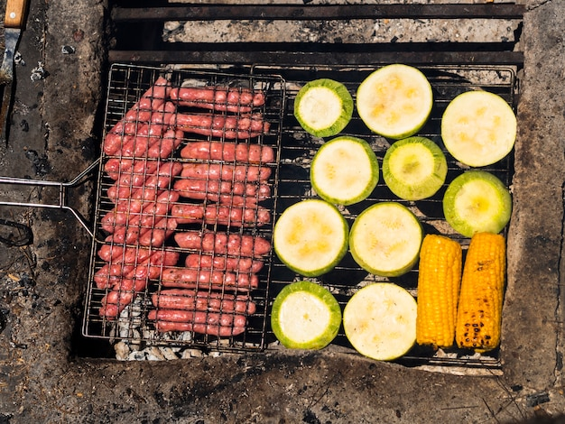 Cooking food on grill grate Free Photo