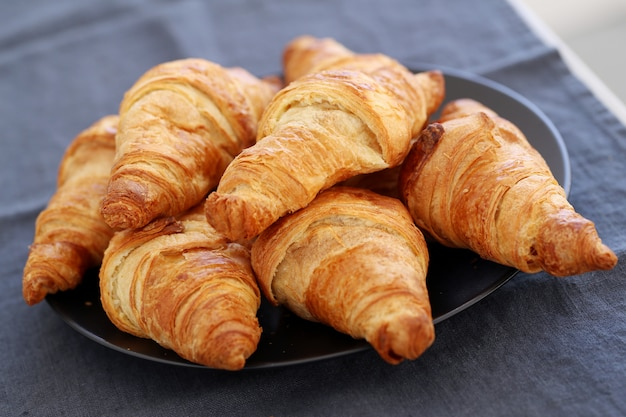 Cooking. heap of croissants on the table Free Photo