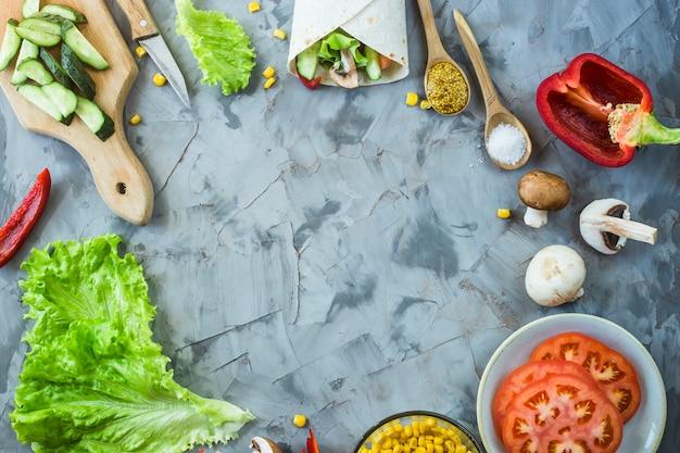 Cooking mexican vegan burrito - vegetables and mushrooms Premium Photo