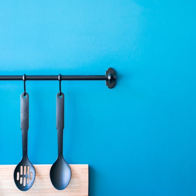 Cooking Utensils Hanging On The Kitchen Wall Blue Minimal