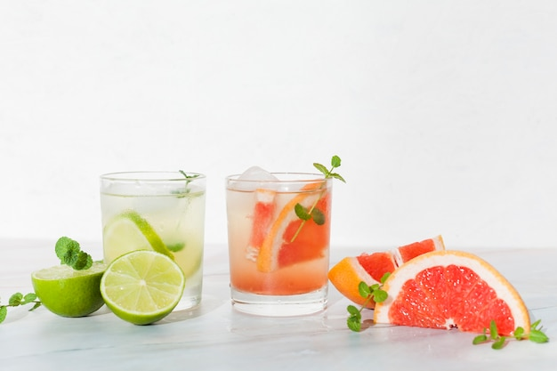 Cool citrus beverages on table Free Photo