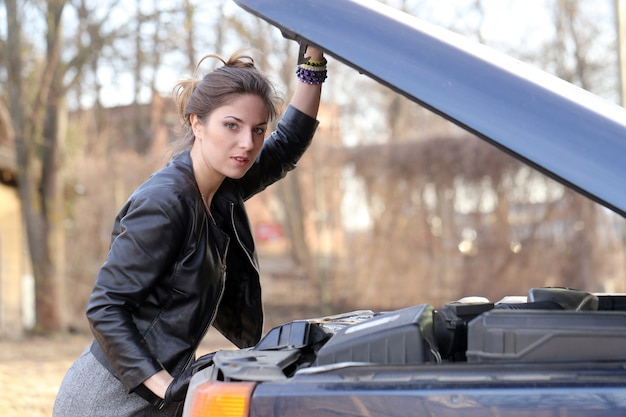 Cool girl by the car Free Photo