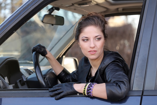Cool girl in the car Free Photo