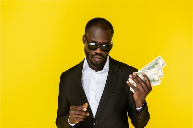 Cool man holding dollars Free Photo