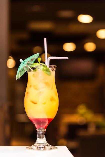 Cool orange cocktail on a blurry background Premium Photo