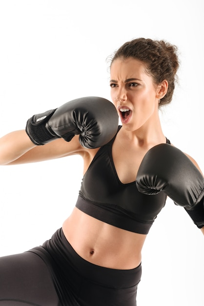 Cool screaming curly brunette fitness woman Free Photo