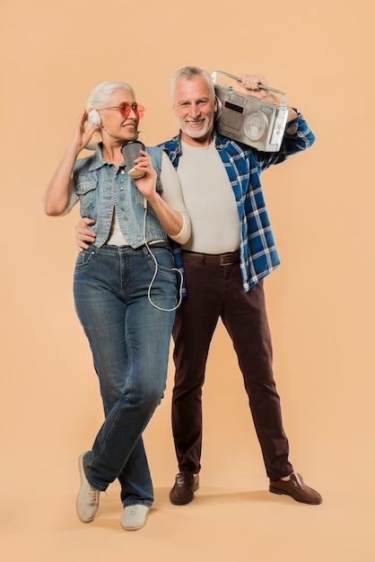Cool senior couple with ghetto blaster Free Photo