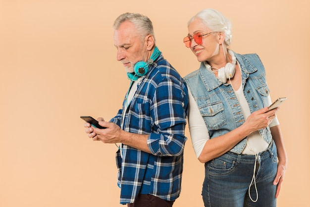 Cool senior couple with smartphone Free Photo