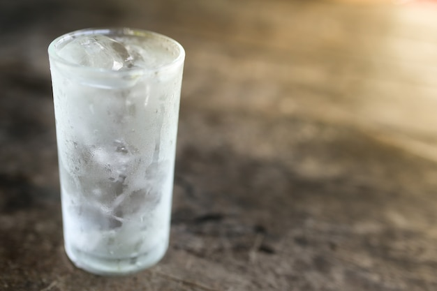 Cool water in glass on wooden table. Premium Photo