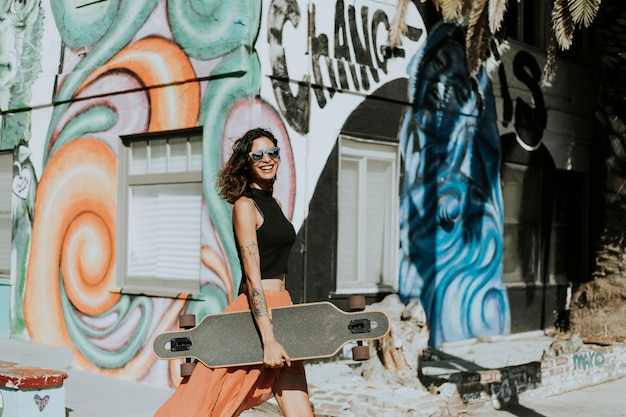 Cool woman with a longboard Free Photo