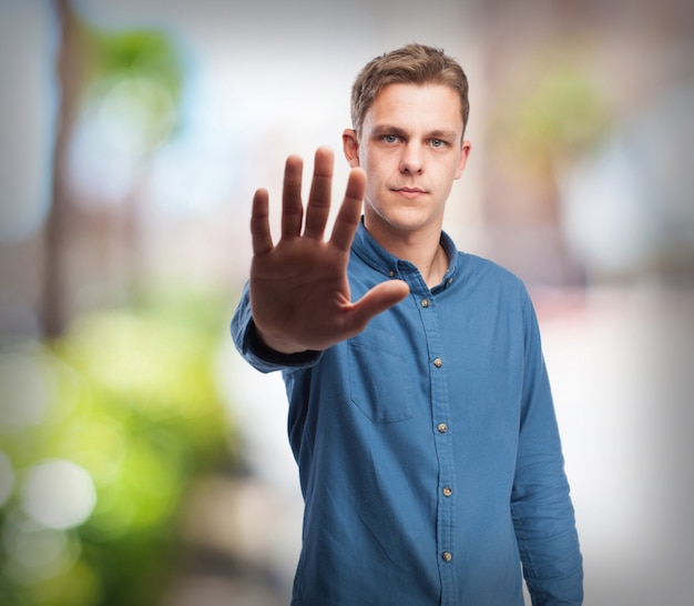 cool young-man stop gesture Free Photo