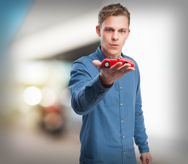 Charmant Cool Young Man With Red Car Free Photo