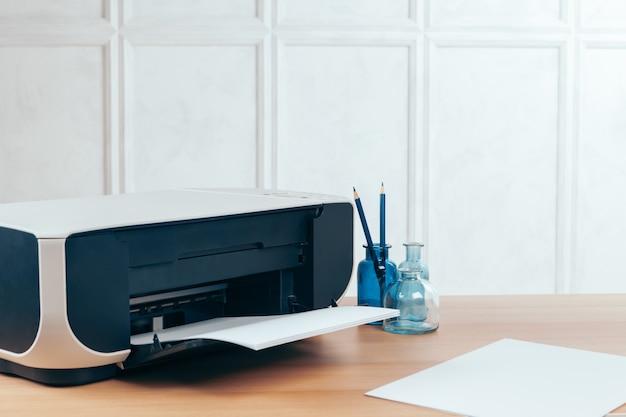 Copier or printer in a modern office interior close up Premium Photo