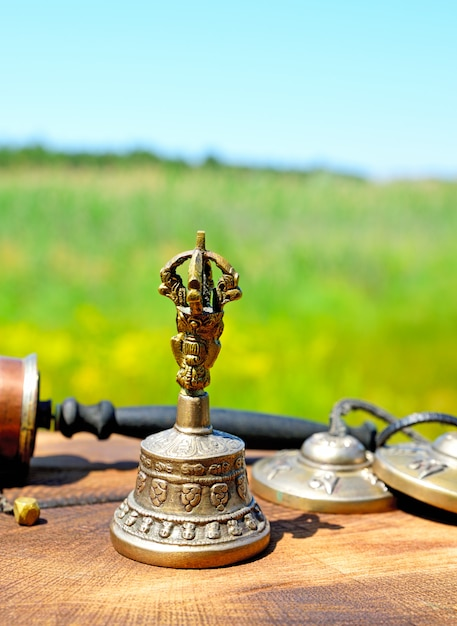 Copper bell with tibetan religious objects Premium Photo