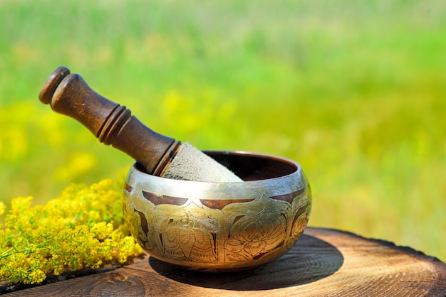 Copper singing bowl with a stick Premium Photo