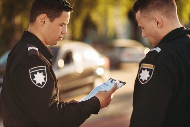 Cops in uniform stop the car on road Premium Photo