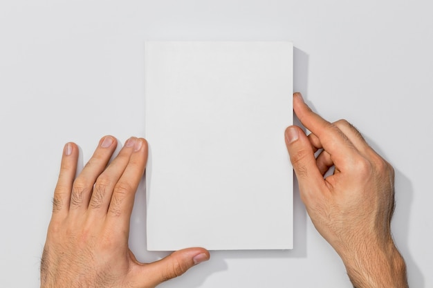 Copy space book and person hands Premium Photo