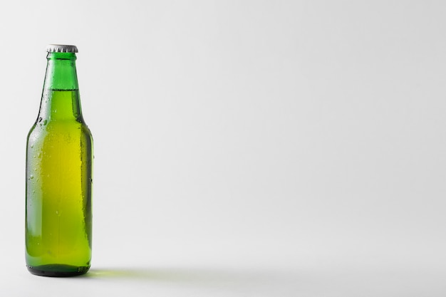 Copy-space bottle of beer on table Free Photo